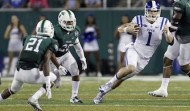 Duke quarterback Thomas Sirk (1) scrambles past Tulane cornerback Donnie Lewis (21), linebacker Nico Marley (20) and defensive end Royce LaFrance (48) in the second half of an NCAA college football game in New Orleans, Thursday, Sept. 3, 2015. Duke won 37-7. (AP Photo/Gerald Herbert)