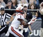 Virginia Tech's Isaiah Ford (1) makes a catch against Purdue's Robert Gregory and Frankie Williams (24) during the first half of an NCAA college football game Saturday, Sept. 19, 2015 in West Lafayette, Ind. (AP Photo/Darron Cummings)