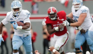 Elijah Hood (left) rushed for 220 yards and two touchdowns in North Carolina's 45-34 win over NC State Saturday. (AP Photo)