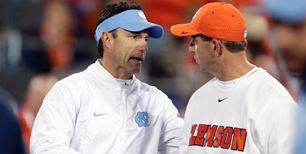 Larry Fedora and Dabo Swinney have faced each other twice as head coaches. (AP Photo)