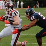 Micah Kiser makes a tackle