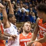 Duke guard Matt Jones and Syracuse guard Malachi Richardson (right) battle for a rebound. (AP Photo)
