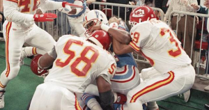Houston's Haywood Jeffires tries to fight off the Chiefs' Derrick Thomas (58) and Bruce Pickens during a scuffle along the sideline. (AP Photo)