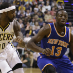 Jerian Grant drives to the basket during his rookie season against Ty Lawson. (AP Photo).