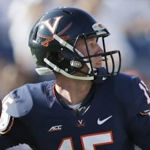 Virginia quarterback Matt Johns is fighting to hold on to his starting spot. (AP Photo)