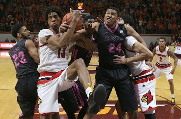 Raymond Spalding (13) competes for a rebound against Virginia Tech. (AP Photo).