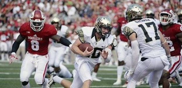 John Wolford runs for one of his two touchdowns against Indiana. (AP Photo).