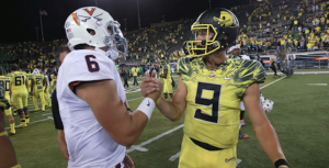 Oregon handed Kurt Benkert (left) and Virginia a 44-26 loss on Sept. 10. (AP Photo)