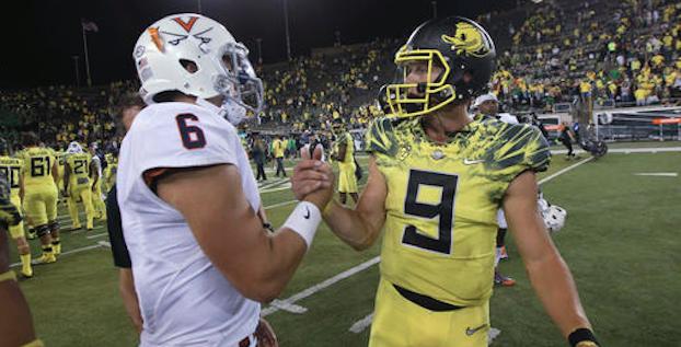 Oregon handed Kurt Benkert (left) and Virginia a 44-26 loss on Sept. 10. (AP Photo)