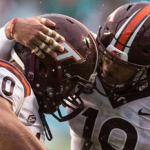 Virginia Tech's Woody Baron (60) and Chuck Clark (19) celebrate following a play against North Carolina during the second half of the Hokies' win in Chapel Hill. (AP Photo/Ben McKeown)