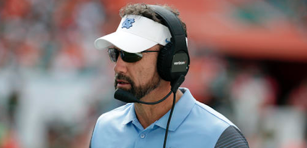 Larry Fedora looks on
