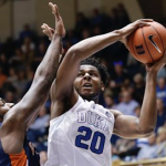 Marques Bolden tries to shoot