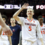 Kyle Guy waves