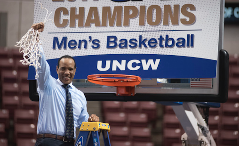 Kevin Keatts celebrates