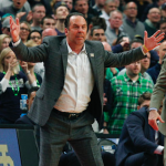 Mike Brey puts hands up