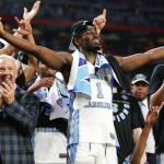 Theo Pinson raises arms