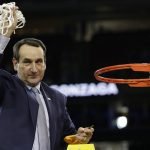 Mike Krzyzewski cuts down the net