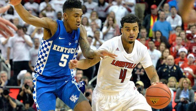 Quentin Snider drives for Louisville basketball