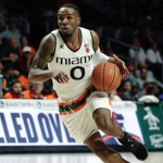 Ja'Quan Newton drives for Miami basketball