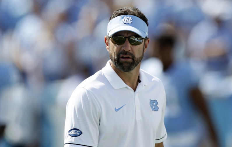 Larry Fedora looks over