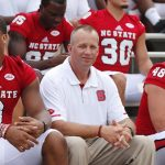 Dave Doeren sitting and smiling