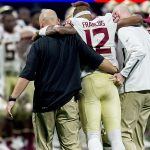 Deondre Francois being helped off the field
