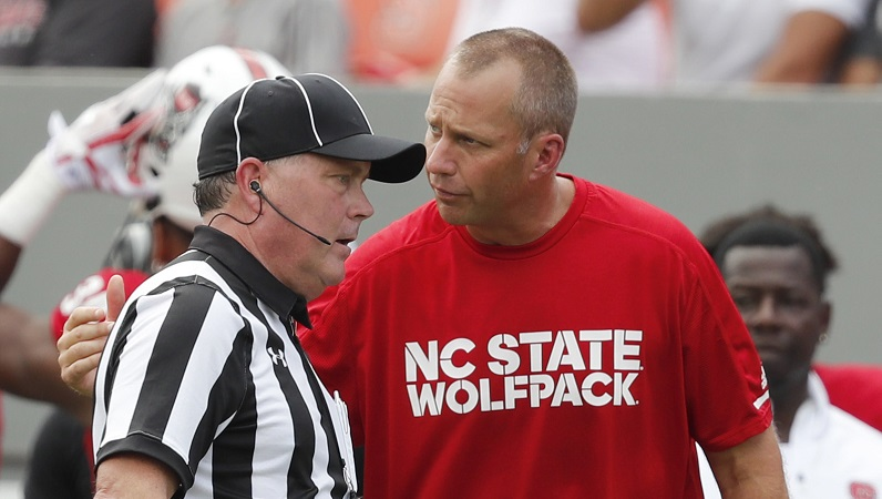 Dave Doeren talks to official