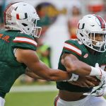 Malik Rosier hands off to Travis Homer