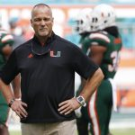 Mark Richt stands in front of his team