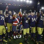 Notre Dame team singing