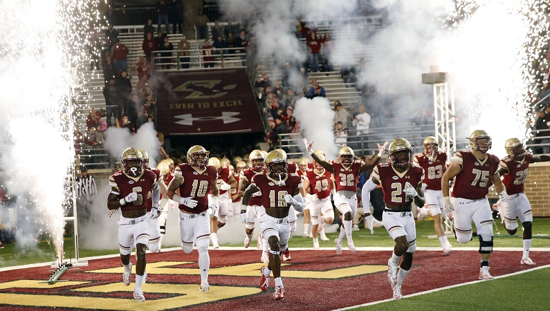 Boston College football team running on to field