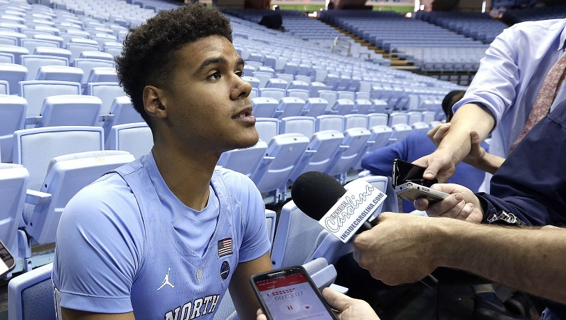 Cameron Johnson talking to media