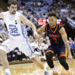 Luke Maye defends
