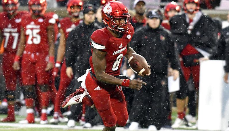 Lamar Jackson runs