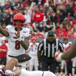 Lamar Jackson throws