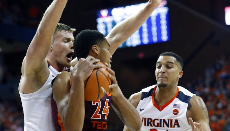 Hunter's 3 helps No. 1 Virginia edge Louisville 67-66