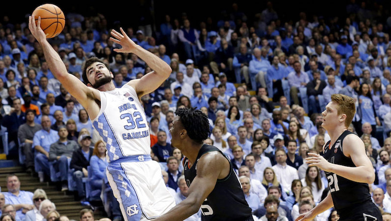 Luke Maye drives