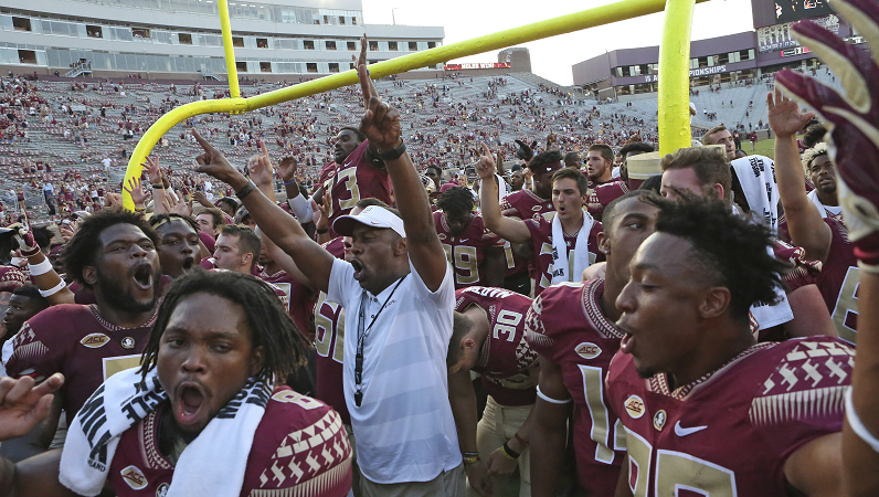 Willie Taggart and the Florida State Seminoles celebrate after a win