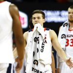 Kyle Guy greets