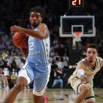 Coby White drives
