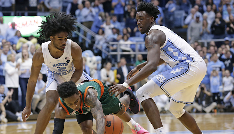 Coby White defends