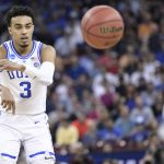Tre Jones passes