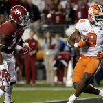 Travis Etienne runs