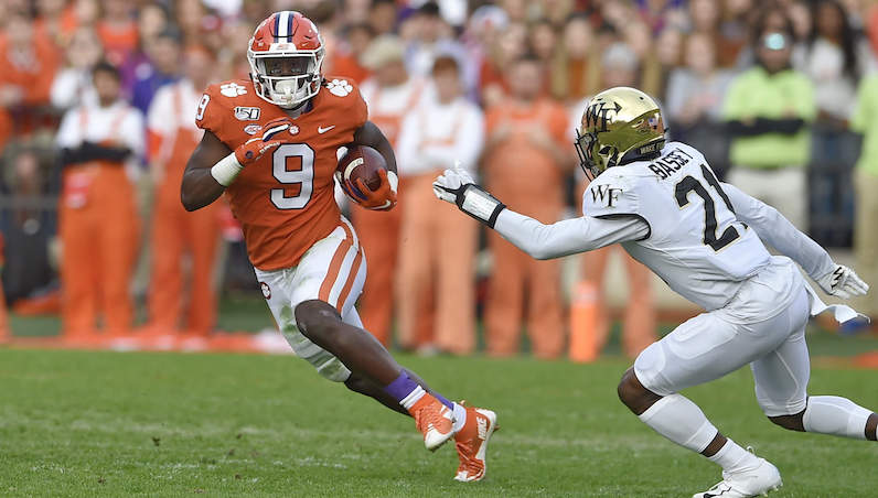 Travis Etienne rushes